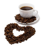 Heart made from coffee and a cup Royalty Free Stock Photography