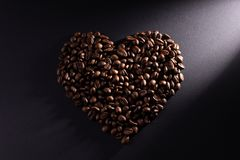 The heart is made of coffee with a diagonal ray brightened to the right stock images