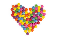 Heart made of colored smarties Stock Photography