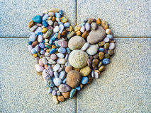 Heart made of colorful pebbles, love and diversity. Heart made of pebbles, symbol and illustration of love romance relationship tolerance diversity religion Royalty Free Stock Photography