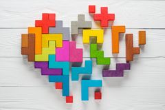 Heart made of colorful wooden shapes, top view, flat lay. Royalty Free Stock Photography