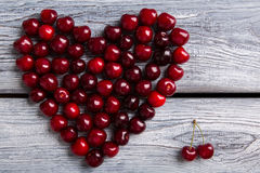 Heart made of dark cherries. Stock Photo