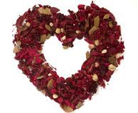 Heart made of dried flowers. Isolated frame of heart made with dried flowers Stock Photos