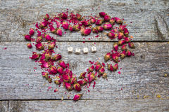 Heart made of dried flowers roses and inscription love Royalty Free Stock Photo