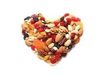 Heart made of dried fruits and nuts on white background. Top view royalty free stock photos