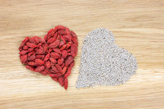 Heart made of dried goji berries and chia seeds Royalty Free Stock Images