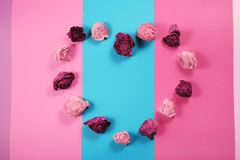 Heart made of dried rose buds, Valentines day background. Heart made of dried rose buds, Valentines day card Stock Photo