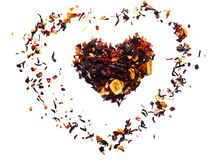 Heart made of dry fruit tea on white background royalty free stock photos
