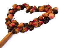 A heart made from dry roses and coffee beans Stock Photos