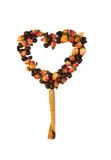 A heart made from dry roses and coffee beans Stock Photography