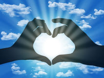 Heart made with fingers on blue sky background Royalty Free Stock Image