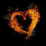 Heart made of fire. On black background Stock Photos