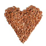 Heart made of flax seeds Linum usitatissimum view from above, stock images