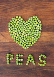 Heart made of fresh locally grown green peas Stock Photos