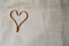 Heart made of a gold chain. Bright, shiny, glamorous, fashionable, expensive heart from jewelry royalty free stock images