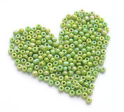Heart made of green beeds. A heart made of green beeds Stock Photos