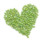 Heart made of green beeds. A heart made of green beeds Royalty Free Stock Image