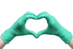 Heart made of green medical gloves isolated on white background. Heart made of green medical gloves, Healthy lifestyle, benefits of vitamins, vaccination, afraid stock photo
