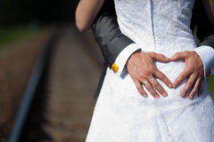 Heart made by groom hands. Heart- symbol of love. Wedding couple Royalty Free Stock Photo