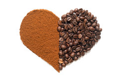 Heart made of ground coffee and coffee beans Royalty Free Stock Photo