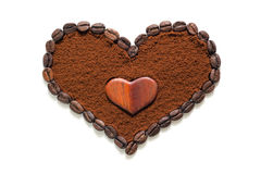 Heart made of ground coffee and coffee beans Stock Image