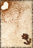 Heart made of ground coffee and flower made of coffee beans on a vintage paper Royalty Free Stock Photography