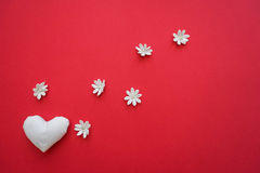 Heart made with hands with flowers. Background for Valentine`s day Royalty Free Stock Image