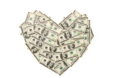 Heart made of hundred dollar banknotes isolated. On white background Royalty Free Stock Images