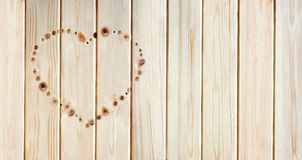 Heart made of knots on the board Stock Photography
