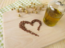 Heart made of linseed and flaxseed oil Stock Photography