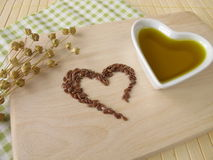 Heart made of linseed and flaxseed oil Stock Photos