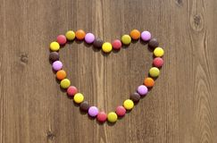 Heart made of colorful candies Stock Images