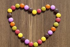 Heart made of colorful candies Stock Photography