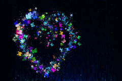 Heart made of multi-colored butterflies. Stars and dots royalty free illustration