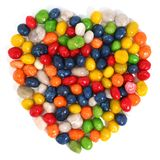 Heart made of multi-coloured sweets with raisin 1. Isolated on white, (look similar images in my portfolio Royalty Free Stock Photography