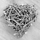 Heart made of nails, for father`s day, anniversary or Valentine Royalty Free Stock Photo