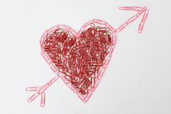 Heart made of office paperclips Stock Images