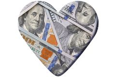 Heart made of one hundred dollars banknotes stock photography