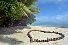Heart made out of coconuts Rarotonga Cook Islands. A romantic heart made out of coconuts on the beach in Rarotonga, Cook Islands. Copy space Stock Photos