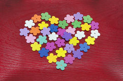 Heart made out of colorful paper flowers Royalty Free Stock Image