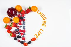 Heart made out fruits with Choose Life message in it with white background. stock photography