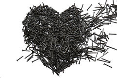 Heart made out of nails. Broken heart Royalty Free Stock Photos
