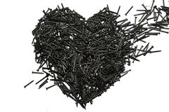 Heart made out of nails. Broken heart Stock Images