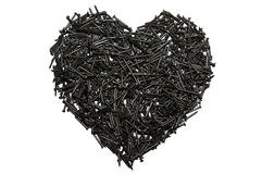 Heart made out of nails. A cruel heart Stock Image