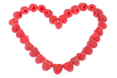 Heart made out of raspberries Stock Image