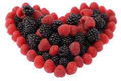 Heart made out of raspberries and blackberries Royalty Free Stock Image