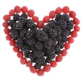 Heart made out of raspberries and blackberries Royalty Free Stock Images