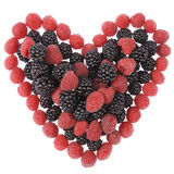 Heart made out of raspberries and blackberries Stock Photos
