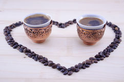 Heart made out of raw grains of coffee Stock Images