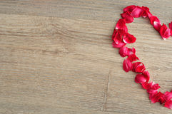 A heart made out of red rose petals Royalty Free Stock Photography